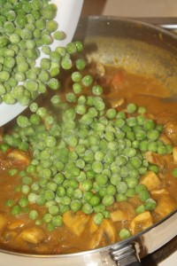 peas pouring into a pan
