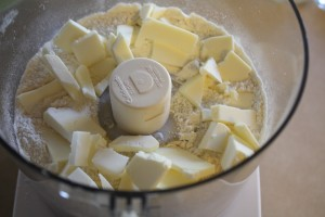 adding butter to dry ingredients