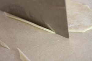 cutting strips of dough