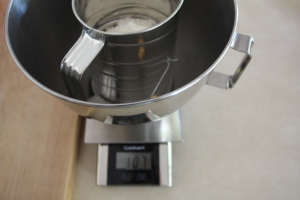weighing flour for sifting