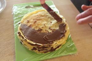 layering a crepe cake