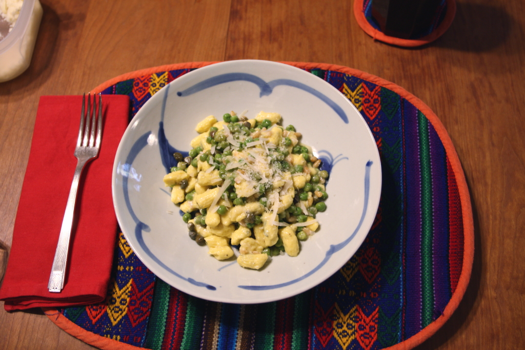Chèvre and Sage Gnocchi with Peas, Capers, and Pine Nuts
