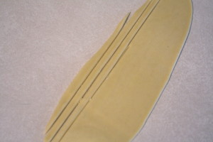 cutting stips of pasta