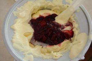 adding cherries to ice cream